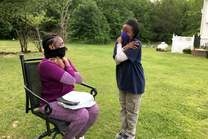 Dr. Marlo Paul gives Ms. Moss a virtual hug during a recent home visit in Alabama's Black Belt.