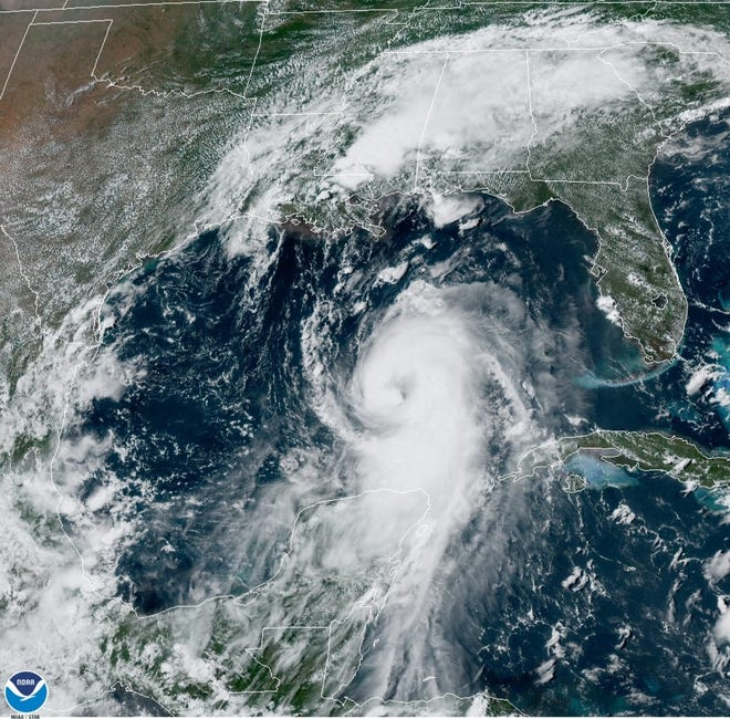 In this August 25, 2020 NOAA satellite photo, Hurricane Laura strengthens in the Gulf of Mexico while Marco drenches parts of the Southeast. (NOAA handout)