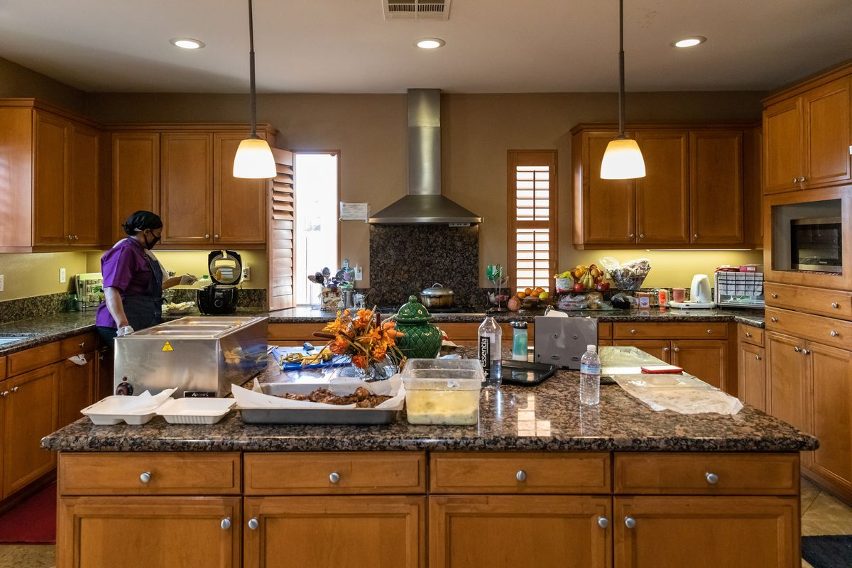 Evon McMurray's home kitchen in Eastvale, California with hanging lights.