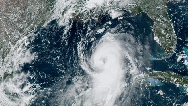 In this August 25, 2020 NOAA satellite photo, Hurricane Laura strengthens in the Gulf of Mexico while Marco drenches parts of the Southeast.